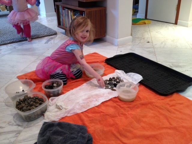 Hired a 3 year old tattooed ballerina and her holly come lately 1 year old sister to help sort big rocks from small rocks and wash with Method hand soap and dry