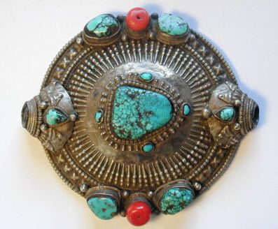 Head Ornament for a married woman, 19. Century, Central Tibet. Material: Silver, Iron,Turquoise, Corall, Bitumen