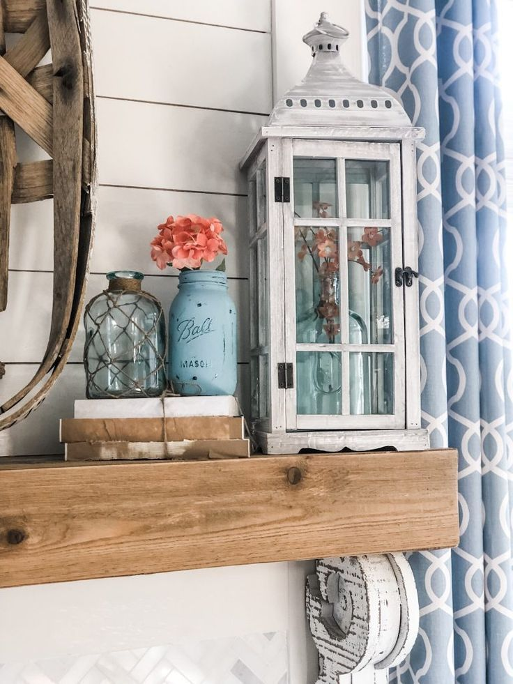 Spring fireplace decorating idea with aqua and coral accents!
