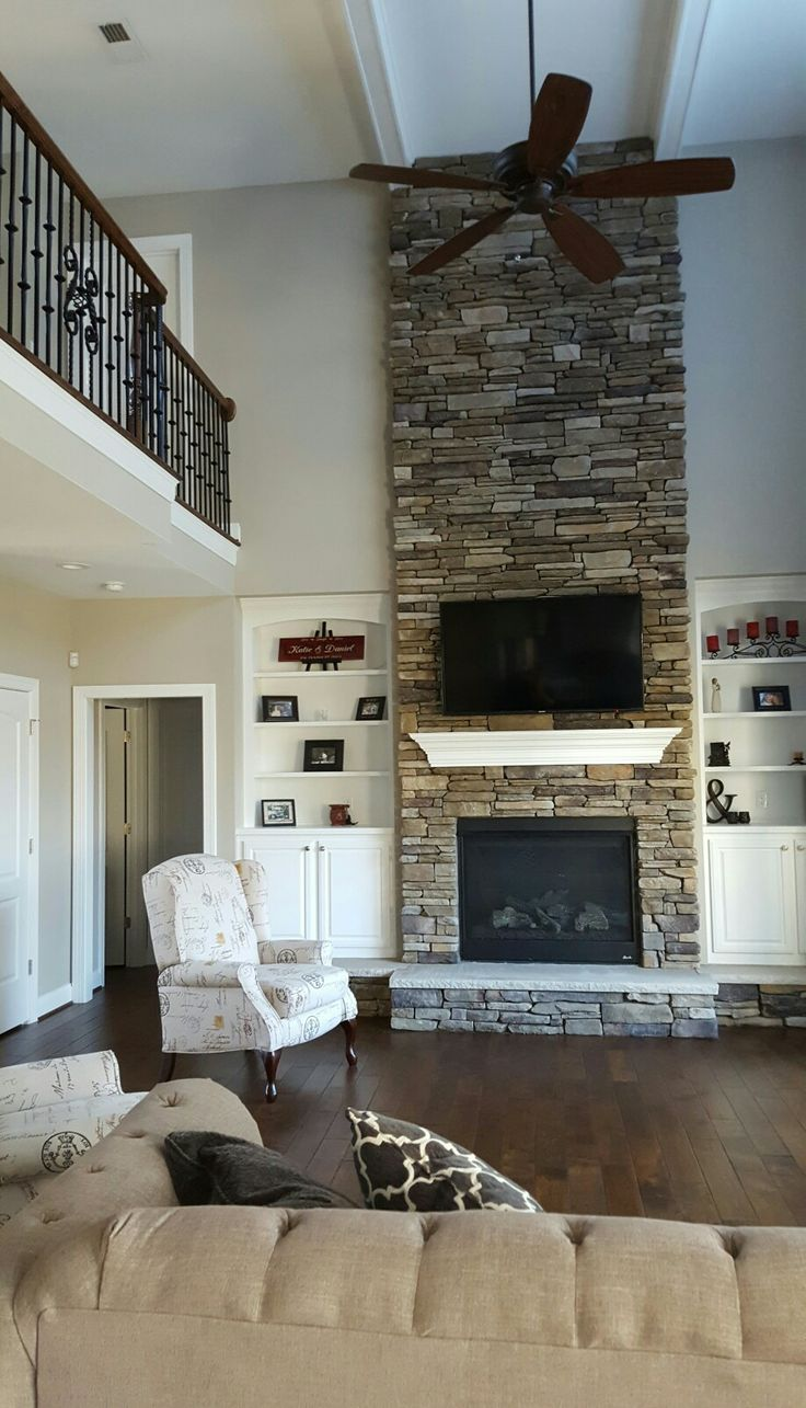 Great room with two story stone fireplace and catwalk.  Boral Bucks County in Southern Ledgestone.  Push back custom recliners are Southern Motion.