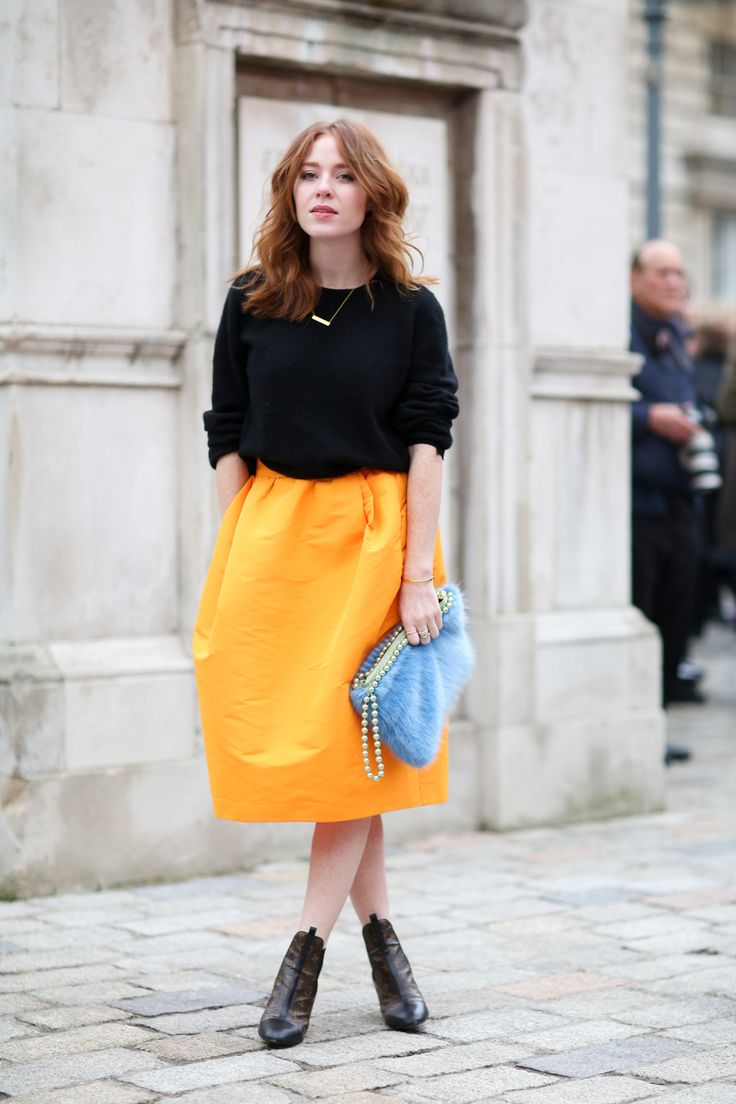 70 Style Lessons From The Streets Of London #refinery29 http://www.refinery29.com/2015/02/82710/london-fashion-week-2015-street-style#slide-4 Yellow and black are truly the bee's knees. Go for the bold hue and add a pop of pastel to finish off the look.