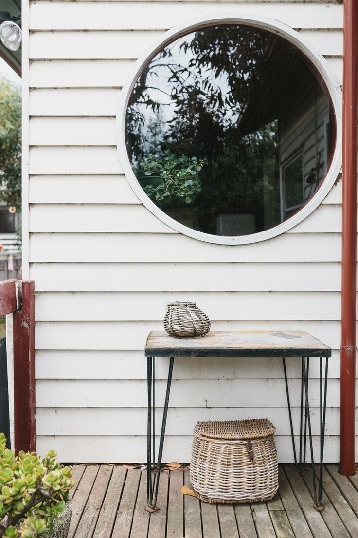 The distinctive round window from the outdoor deck, vintage fly fishing basket.