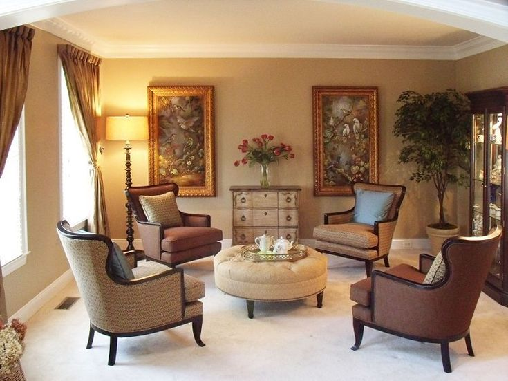 A formal living room with delicate touches and accents throughout  design by Val Valdez at
