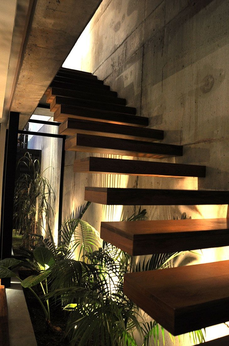 Some great looking floating stairs. They just look so high quality. Cool concrete walls.
