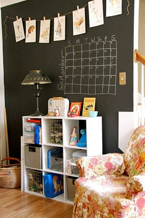 Paint a wall with chalkboard paint. Use clothes pins to hang kids art work.