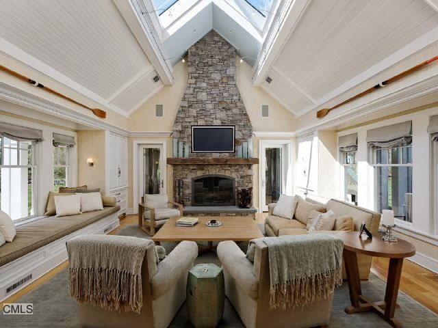 This Two Story Family Room Featuring A Floor To Ceiling
