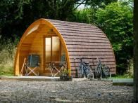 Set in the picturesque North Devon countryside near the Cornish coast of England,  Quarry Pods at Dunsdon Farm  offer a choice of five modern but quaint pods with private washroom/shower facilities.