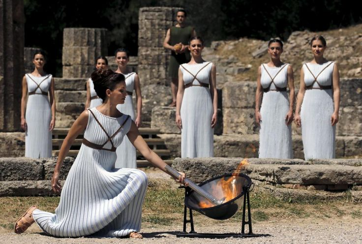 Greek actress Katerina Lehou, playing the role of High Priestess, lights a torch from the sun's rays reflected in a parabolic mirror during the dress rehearsal for the Olympic flame lighting ceremony for the Rio 2016 Olympic Games at the site of ancient Olympia in Greece. REUTERS/Yannis Behrakis