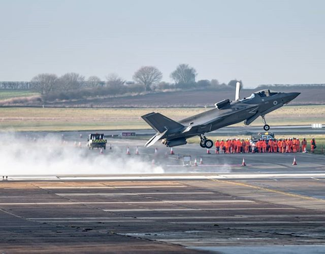 F35b Performing A Short Take Off A Few Spectators In The