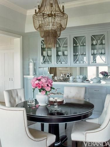 Colors -- Light Blue, Espresso, White, Gold (and coral accent vs flowers) --- Turquoise blue dining room design with gray blue cabinets, round black pedestal dining table with white trim, cream tufted chairs with nailhead trim. MINUS The | http://apartmentdesigncollections.blogspot.com