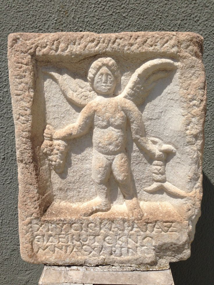 Winged figure with grapes and snakes