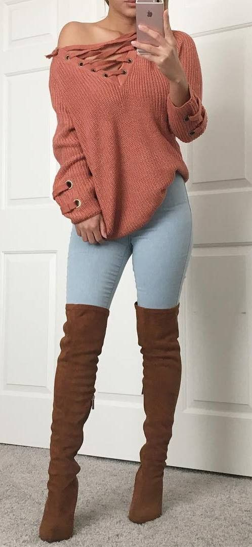 how to wear brown over the knee boots: one shoulder sweater + skinny jeans