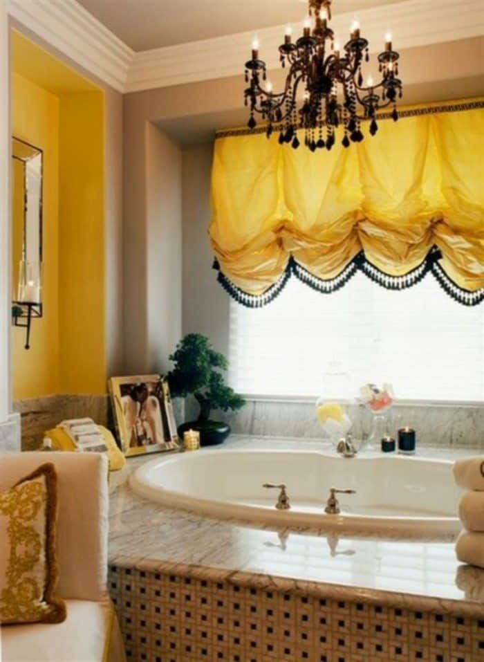 bathroom with black chandelier over drop in tub and yellow balloon rh pinterest com