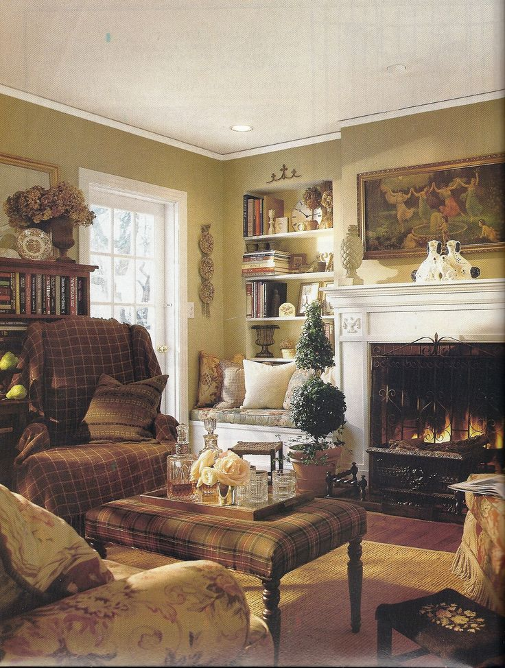 This house was featured in a magazine many years ago and I've saved the article in my inspiration folder (pre-Pinterest). I copied the wall color, fireplace and screen among other things. I still love this room.