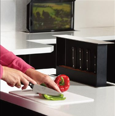 Knife Box by S-Box.  Increase counter top storage space.  Knife box pops up out of the counter!  Brilliant.