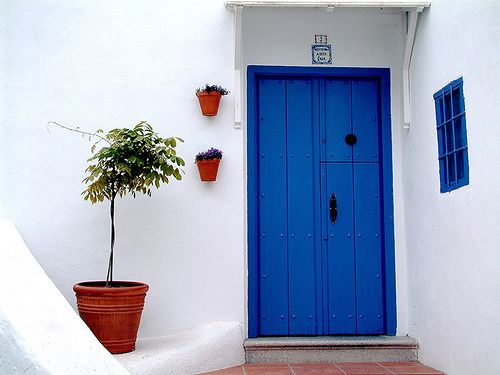 What does a blue front door symbolize?