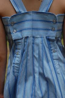 Upcycled men's dress shirt into girls dress.  Love the use of the intact sleeves for the back of the dress~~Daddy's Little Girl Dress   Pinafores & Pinwheels