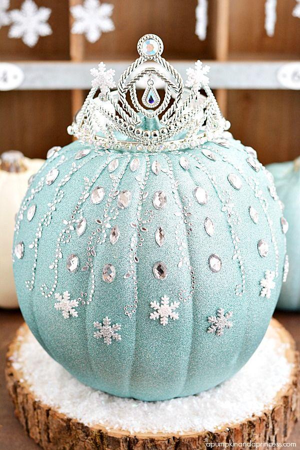 DIY Disney Frozen Elsa Pumpkin – a sparkly pumpkin made with glitter, rhinestones, and snowflakes that every little princess will enjoy!