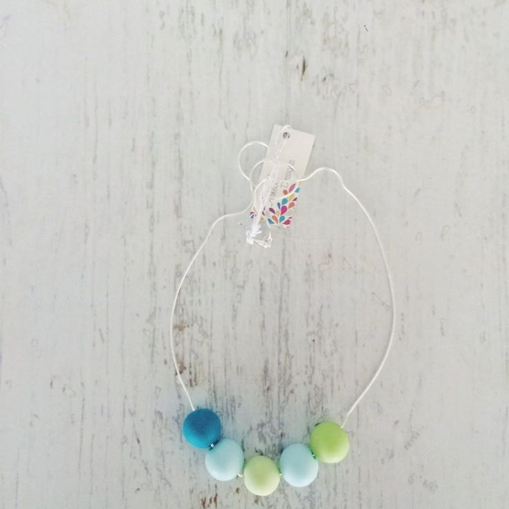 """Beautiful Australian Handmade Necklace.Each necklace is made using clay beads, hanging on a 20"""" (55cm) sterling silver chain (925). Each bead is individually handmade, with their own unique character."""