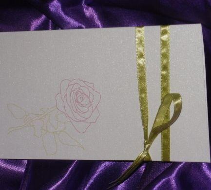 Invitatie de nunta Rose Pass realizata din carton ivoire sidefat si accesorizata cu o panglica ingusta olive. Pe plicul invitatiei este imprimat un trandafir delicat. Textul te trimite cu gandul la...