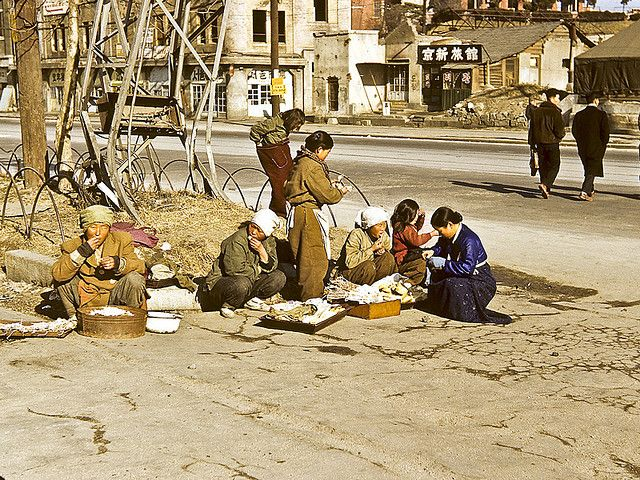 Open Air Market, Downtown Seoul, common wartime sight for citizens eking out a living. Photo by Dewey McLean, 1952-53.