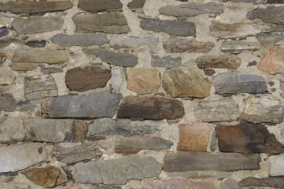Painting a stone wall white brightens a room.