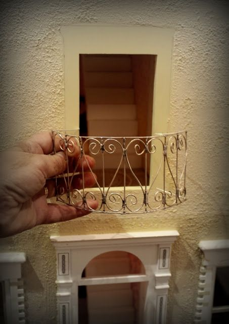 TUTORIAL French Balcony railing... Draw design on paper.  Bend wire to match design.  Soldered wire at connection points.  Paint.
