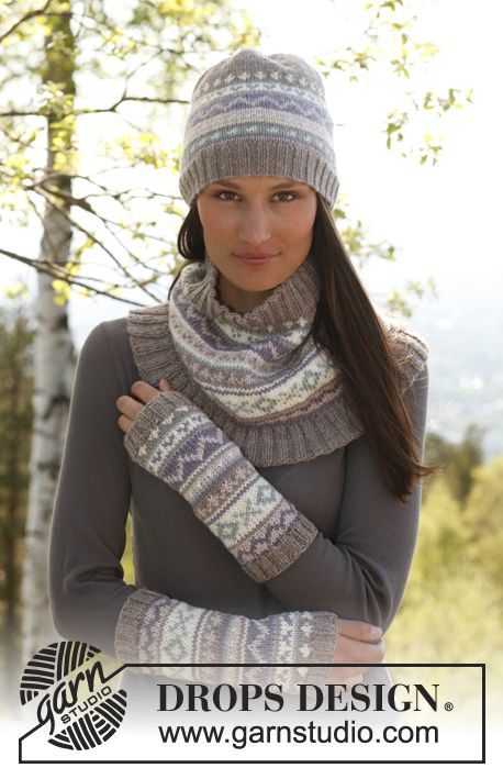 "Set consist of: Knitted DROPS wrist warmers, hat and neck warmer with pattern borders in ""Karisma""."