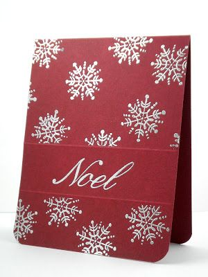 christmas card from Our Change of Art ... red with white stamped snowflakes .. wide ribbon band embossed with NOEL ...