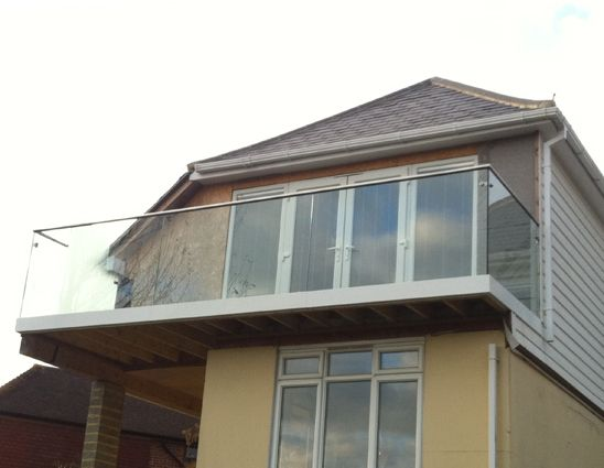 External glass balustrade on this home in Pett, East Sussex.