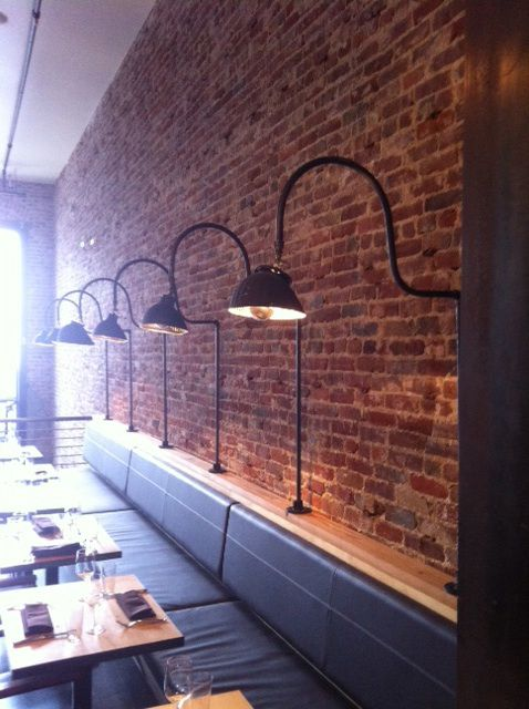Love the lighting, especially if ceilings are too high or it is not easy to hang lights due to exposed plumbing and ductwork. Genius! -mm