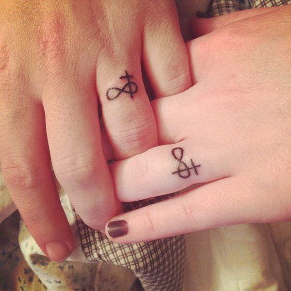 Infinity & Cross Wedding Band Tattoos.
