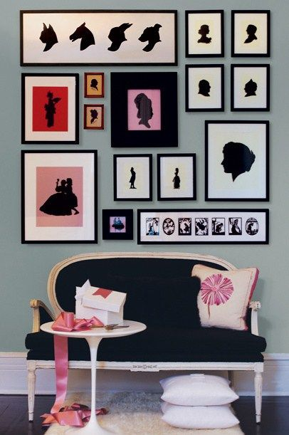 """Love the gallery wall of silhouettes--animals and people.  What a fun way to do a family """"pictures"""" wall!"""