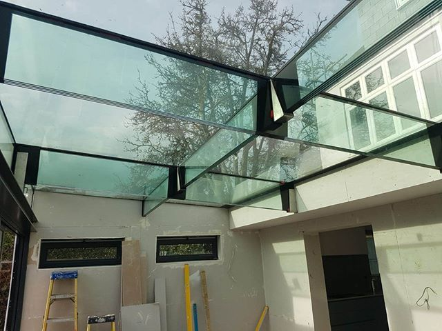 Suspended Glass Roof With Over 1 Ton Of Glass Hung Off Glass Lintels And Metal Hangers Even The Mild Steel Shoes Glass Roof Metal Hangers Sliding Folding Doors