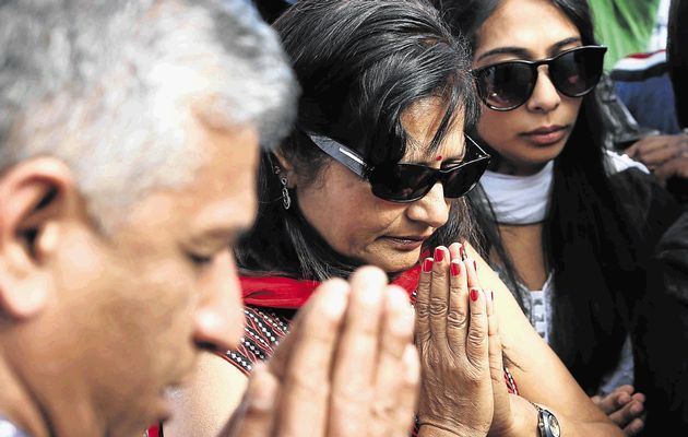 The mother of Anni Dewani, Nilam Hindocha centre, prays with her family at the spot at which her daughter's body was found in Khayelitsha.