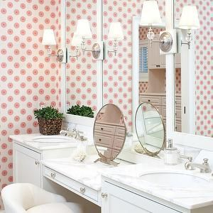 Terrat Elms Interior Design - bathrooms - pink bathroom, adorable bathroom, white and pink, white and pink bathroom white and pink wallpaper, bathroom wallpaper, white bathroom cabinets, shaker cabinets, white shaker bathroom cabinets, white shaker cabinets, white vanity stool, vanity stools, white framed mirror, framed bathroom mirrors, white farmed bathroom mirrors, marble countertops, drop-down vanity, marble vanity, marble drop-down vanity, double sinks, oval mirror, oval vanity mirror…