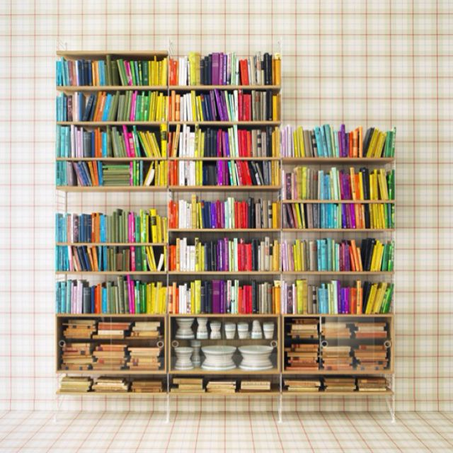 Pretty colorful bookshelf. Color coordination is essential in organization.