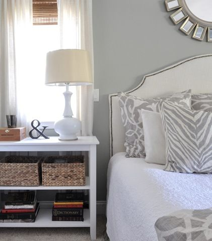 bookshelf as nightstand, with baskets for storage