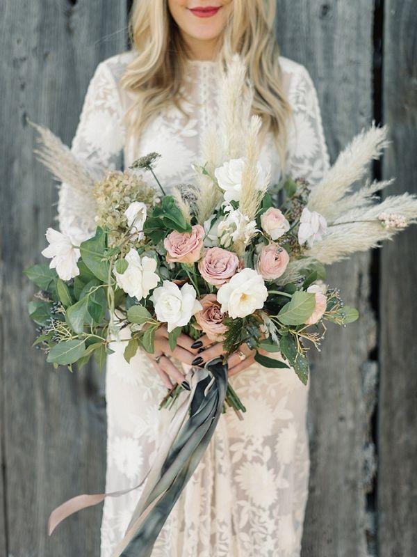 A Coastal Wedding Bouquet with Neutral Flowers and Pampas Grass | Taralynn Lawton Photography on @heyweddinglady via @aislesociety