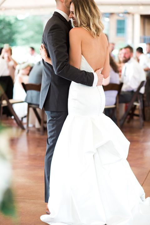 """A heartfelt first dance - that smile says it all. """"Gywneth"""" wedding gown by Matthew Christopher. #marriedinmatthew #matthewchristopher Photo: Lindsay Campbell Photography"""