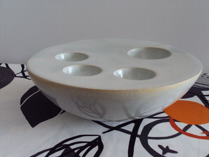 Stoneware double bowl for candles.