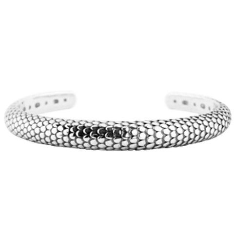 Lizard bangle | ANTIKA Sterling silver cuff bangle with scale-pattern. It's heavy, 9mm wide and 65mm inner diameter. The bangle is oxidised to enhance the pattern.
