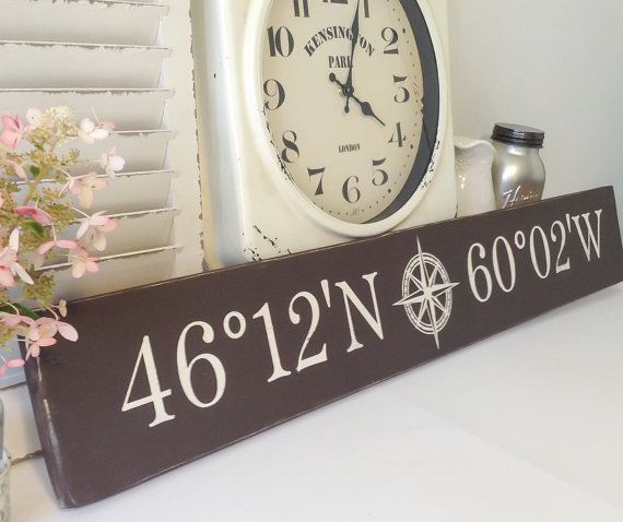 Bridge the gap with this latitude and longitude wooden sign to mark the distance between you and a loved one or to commemorate a special location in your life. Where you met, where you were married maybe even where you grew up! Custom tailored in vivid detail, it features a long horizontal plank that is hand painted in brown latex and features your choice of location spelled out using authentic latitude and longitude coordinates. A decorative compass accent in the center completes the…