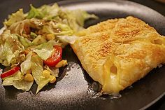 http://www.chefkoch.de/rezepte/772631180163976/Pizza-Blaetterteig-Taschen.html