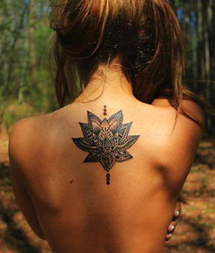 Tribal Lotus Upper Back Tattoo Ideas for Women at MyBodiArt.com