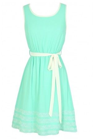A refreshing summer dress with a cream belt cinched at the waist.