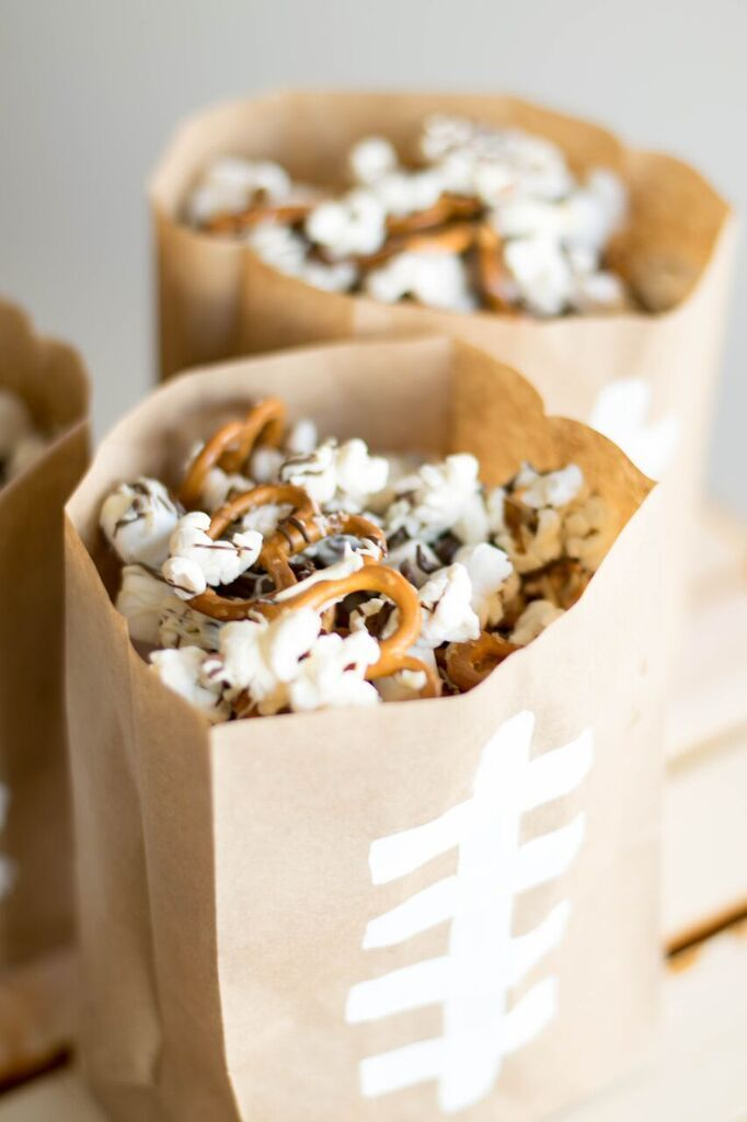 Every football watch party needs a snack, and this sweet and salty combination will have any fan cheering. This treat's shopping list is simple: Rold Gold pretzels, Smartfood popcorn, and your choice of melted chocolate. Via Best Friends for Frosting.
