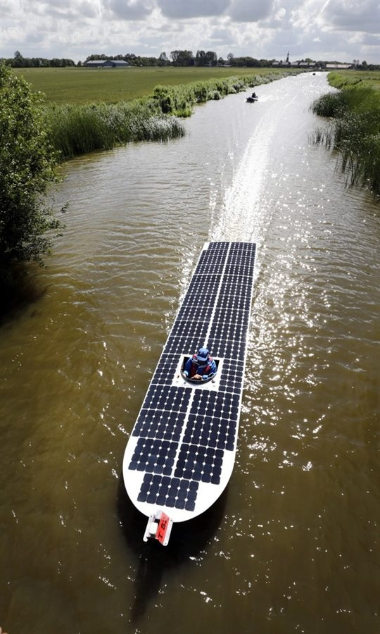 """World Cup for Solar Powered Boats"" - A solar boat from Maasdijk (Netherlands) sails from Arum to Harlingen during the Dong Energy Solar Challenge held in Leeuwarden, the Netherlands, on July 13. The solar boats have to pass a distance of 136 miles (220 kilometres) in six days"