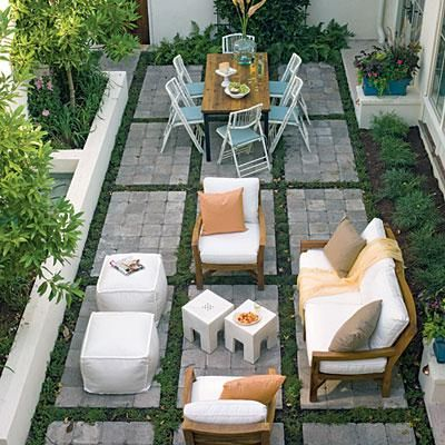 In this long rectangular outdoor room, matching color schemes for each space (warm tones in the seating area and blue in the dining space) tie the areas together. Coastalliving.com