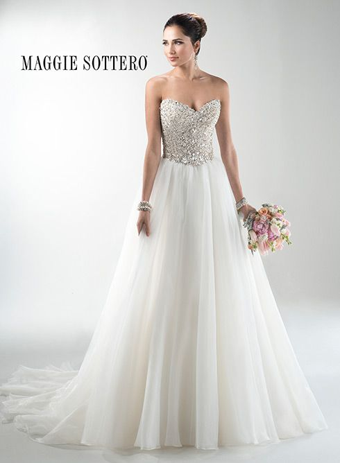 Fairytale ballgown with fully encrusted Swarovski crystal bodice and glamorous organza skirt. Finished with strapless, sweetheart neckline.